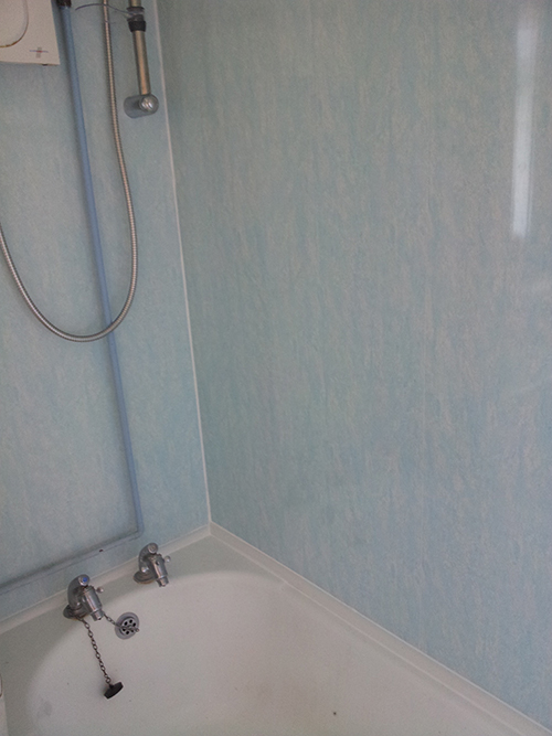WE COVERED THE TILES WITH UPVC BATHROOM CLADDING.