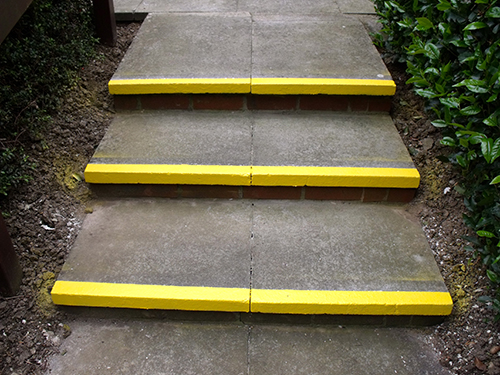 PAINT A YELLOW STRIPE ON ALL THE STEPS